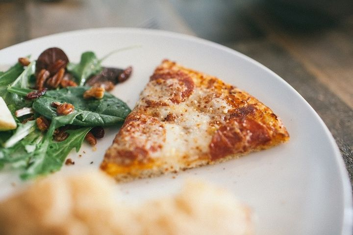 Happiness is a slice of pizza.