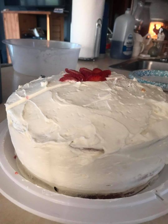 Vanilla cake with fresh strawberry sauce and whipped cream frosting.