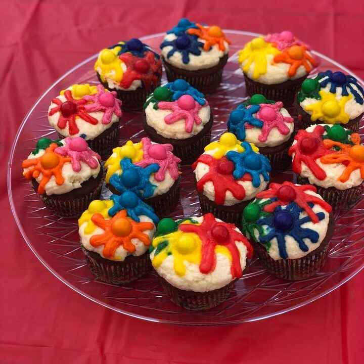 """Paintball ThemedChocolate cupcakes topped with vanilla buttercream to resemble splatter and bubblegum """"paintballs"""""""